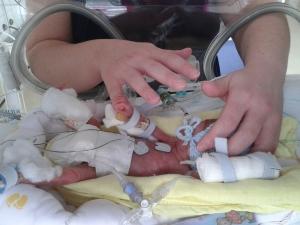 Hugo gripping my finger