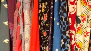 The array of bright colours of the dresses in my wardrobe.