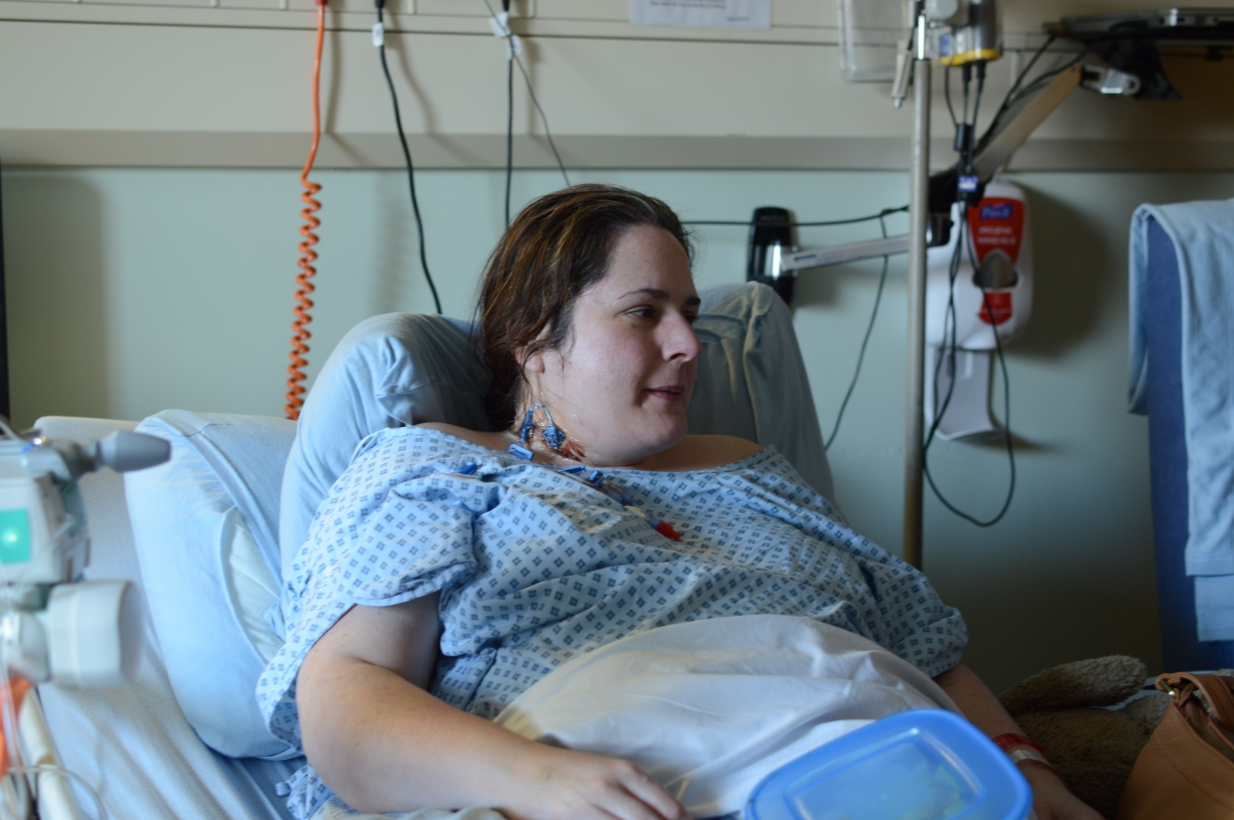 Me in Bedford Hospital. You can see the central line in my neck, and how big I was becoming (besides me being 24 weeks' pregnant).