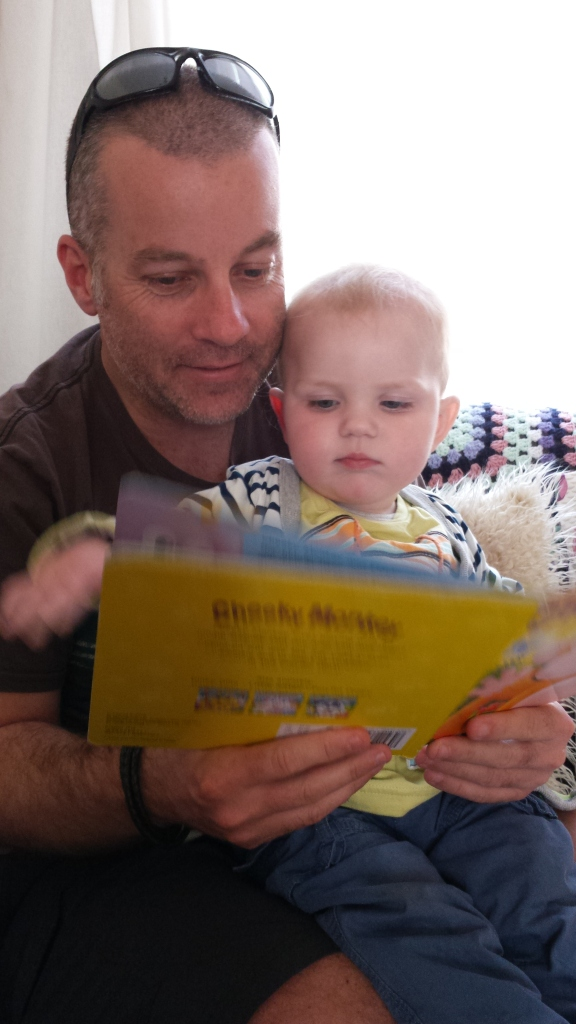 Martin and the baby enjoying reading a book.