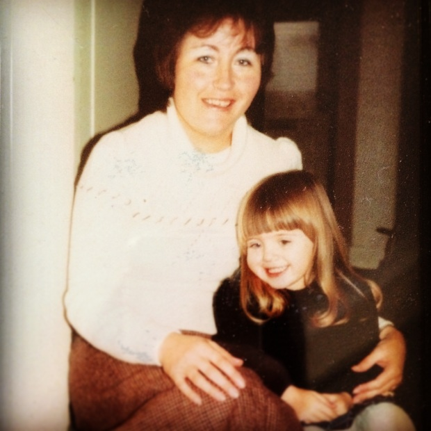Suzanne, aged about 7 or 8, with her Mum.