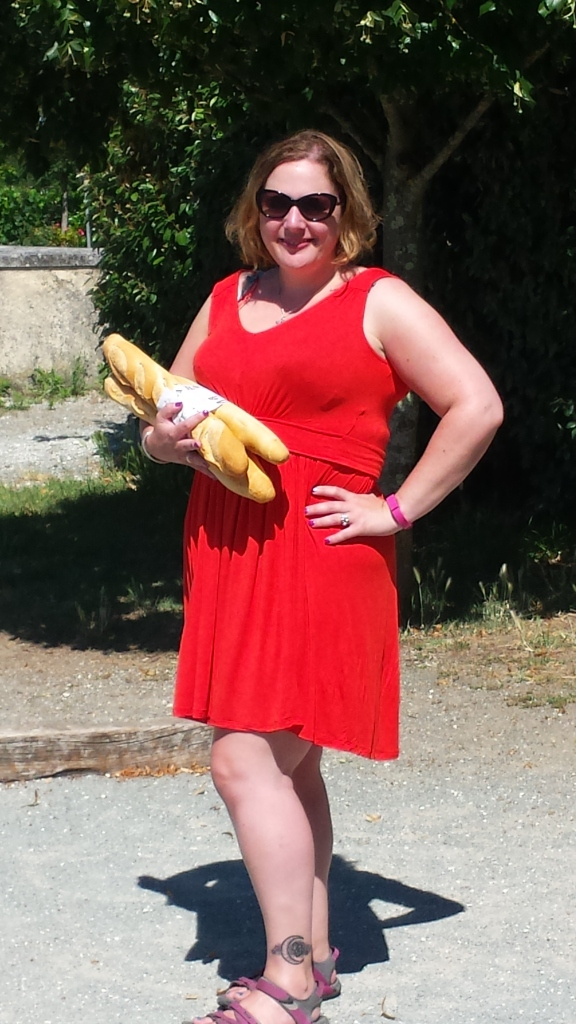 Wearing my Naf Naf dress while holding baguettes, just to prove I really was in France...