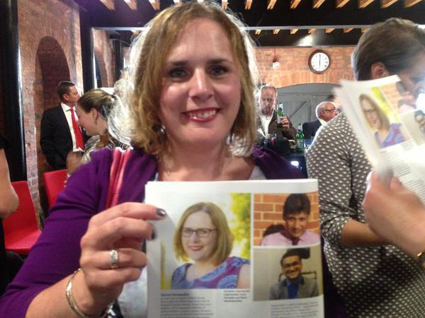 Me at the event, holding a copy of the supplement.